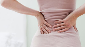 Почему может болеть поясница у женщин